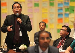 Participants speak at a meeting in Bangkok.