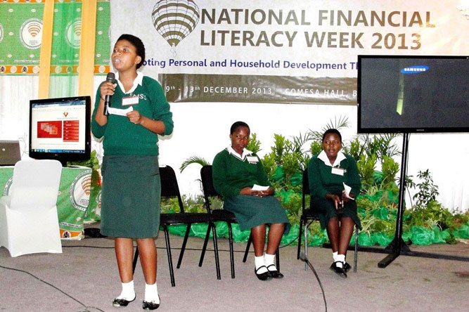 Students discuss financial literacy issues in Malawi.