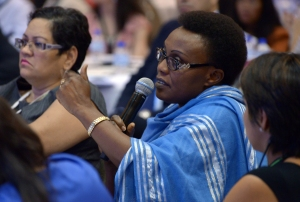 A 2014 GPF participant asks a question during a the Financial literacy: Empowering consumers, improving lives session.